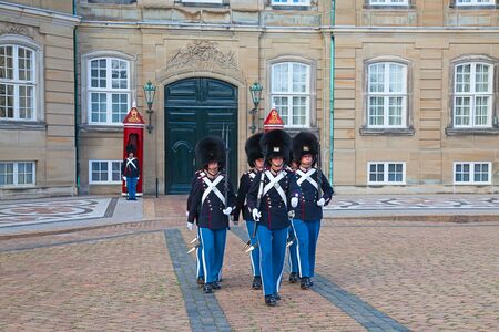 the trappings: COPENHAGEN, DENMARK - AUGUST 25: unidentified soldiers of the Royal Guard in Amalienborg Castle by changing the guards on August 25, 2010 in Copenhagen, Denmark Editorial