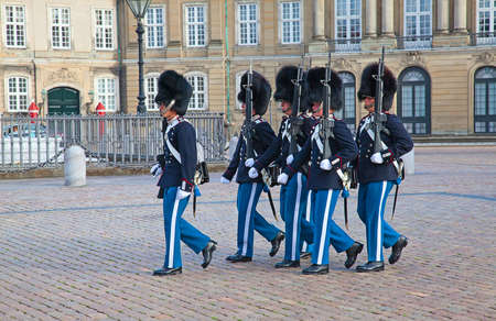 the sentinel: COPENHAGEN, DENMARK - AUGUST 25: unidentified soldiers of the Royal Guard in Amalienborg Castle by changing the guards on August 25, 2010 in Copenhagen, Denmark Editorial