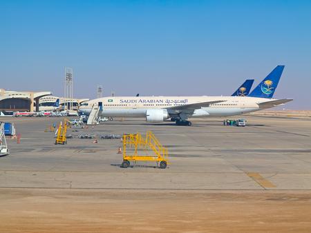 ksa: Riyadh - March 01:  Planes preparing for take off at Riyadh King Khalid Airport on March 01, 2016 in Riyadh, Saudi Arabia. Riyadh airport is home port for Saudi Arabian Airlines.