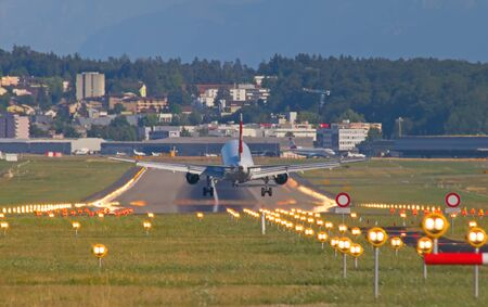 long haul journey: ZURICH - JULY 18: Swiss A-320 landing in Zurich airport after short haul flight on July 18, 2015 in Zurich, Switzerland. Zurich airport is home port for Swiss Air and one of the biggest european hubs. Editorial
