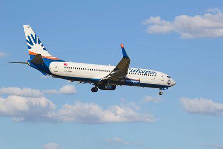 hubs: ZURICH - JULY 18: Boeing-737 Sun Express landing in Zurich after short haul flight on July 18, 2015 in Zurich, Switzerland. Zurich airport is home for Swiss Air and one of biggest european hubs.