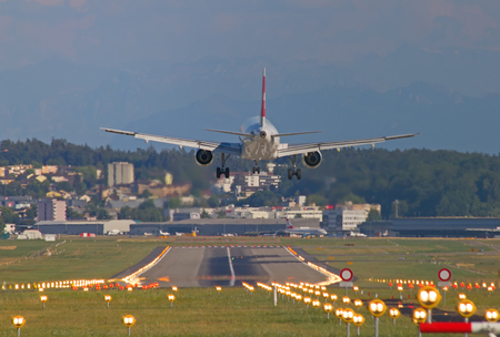 hubs: ZURICH - JULY 18: Swiss A-320 landing in Zurich airport after short haul flight on July 18, 2015 in Zurich, Switzerland. Zurich airport is home port for Swiss Air and one of the biggest european hubs. Editorial