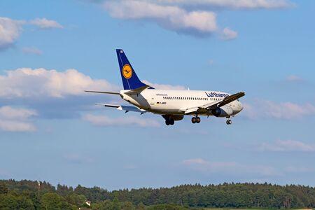 long haul journey: ZURICH - JULY 18: Boeing-737 Lufthansa landing in Zurich after short haul flight on July 18, 2015 in Zurich, Switzerland. Zurich airport is home for Swiss Air and one of biggest european hubs. Editorial