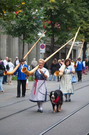 alphorn: ZURICH - AUGUST 1: Swiss National Day parade on August 1, 2009 in Zurich, Switzerland. Musicians in a historical costumes.