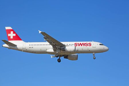 long haul journey: ZURICH - JULY 18: A-320 landing in Zurich airport after short haul flight on July 18, 2015 in Zurich, Switzerland. Zurich airport is home port for Swiss Air and one of the biggest european hubs.
