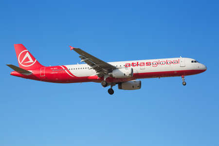 long haul journey: ZURICH - JULY 18: A-321 Atlas global landing in Zurich airport after short haul flight on July 18, 2015 in Zurich, Switzerland. Zurich airport is home port for Swiss Air and one of the biggest european hubs. Editorial