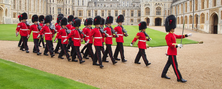 royal guard: WINDSOR - APRIL 16: Unidentified men members of the royal guard during change ceremony on April 16, 2016 in Windsor, United Kingdom. Editorial