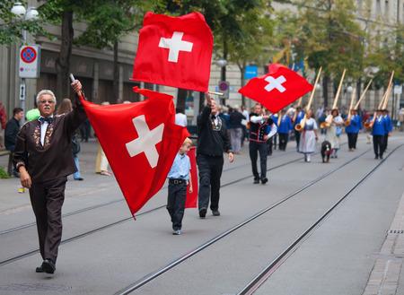 helvetica: ZURICH - AUGUST 1: Swiss National Day parade on August 1, 2009 in Zurich, Switzerland. Representative of canton Appenzeller in a historical costume. Editorial