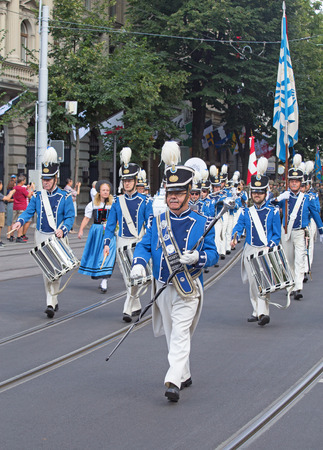 helvetica: ZURICH - AUGUST 1: Zurich city orchestra in traditional costumes openning the Swiss National Day parade on August 1, 2016 in Zurich, Switzerland.
