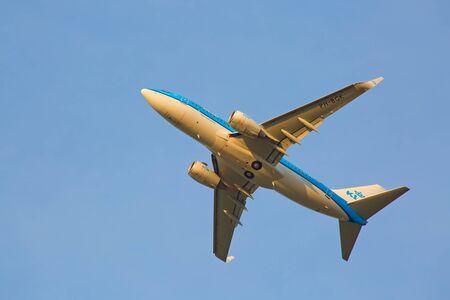 long haul journey: ZURICH - JULY 18: Boeing-737 KLM taking off at sunset from Zurich after short haul flight on July 18, 2015 in Zurich, Switzerland. Zurich airport is one of biggest european hubs.