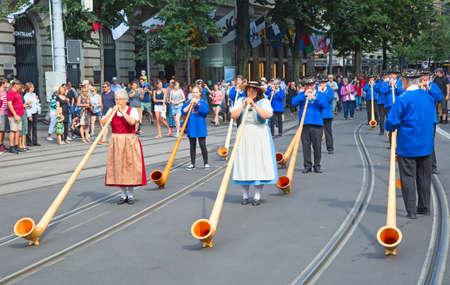 alphorn: ZURICH - AUGUST 1: Swiss National Day parade on August 1, 2016 in Zurich, Switzerland. Musician in a historical costumes.