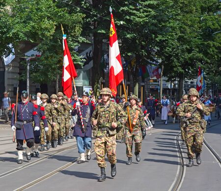 helvetica: ZURICH - AUGUST 1: Swiss National Day parade on August 1, 2016 in Zurich, Switzerland. Representative of swiss army in a historical costumes.