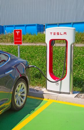 supercharger: ZURICH - July 30:  Tesla Supercharger station on July 30, 2016 in Zurich, Switzerland. Tesla motors develops network of the charging stations across Europe and World.