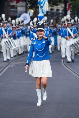 ZURICH - AUGUST 1: Zurich city orchestra in traditional costumes openning the Swiss National Day parade on August 1, 2016 in Zurich, Switzerland.
