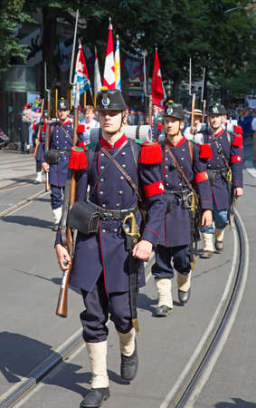 helvetica: ZURICH - AUGUST 1: Swiss National Day parade on August 1, 2016 in Zurich, Switzerland. Representative of swiss army in a historical costume.