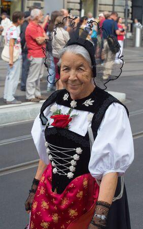 helvetica: ZURICH - AUGUST 1: Swiss National Day parade on August 1, 2016 in Zurich, Switzerland. Woman in a historical costume.