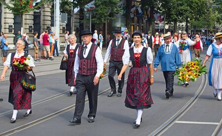 cantons: ZURICH - AUGUST 1: Swiss National Day parade on August 1, 2016 in Zurich, Switzerland. Representatives of cantons in a historical costume.