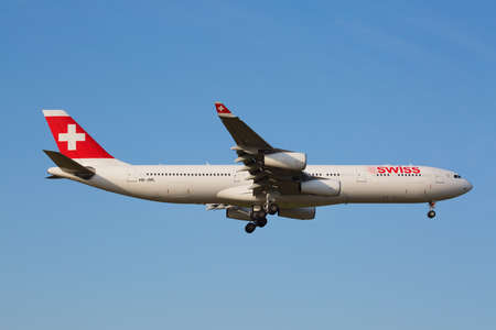 hubs: ZURICH - JULY 18: Swiss A-340 landing in Zurich airport after intercontinental flight on July 18, 2015 in Zurich, Switzerland. Zurich airport is home port for Swiss Air and one of the biggest european hubs.
