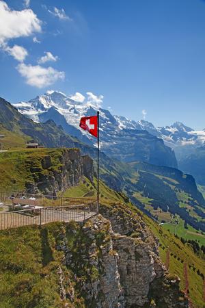 Swiss flag on the top of Mannlichen (Jungfrau region, Bern, Switzerland) Stock Photo
