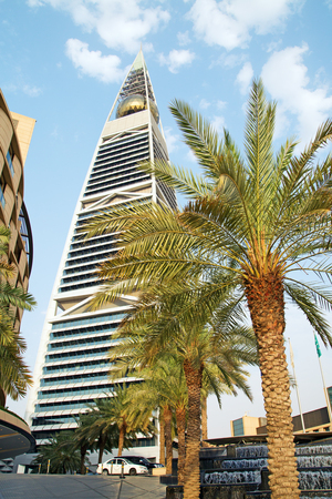 ksa: RIYADH - AUGUST 22: Sunset light at Al Faisaliah tower facade on August 22, 2016 in Riyadh, Saudi Arabia. Al Faisaliah towers is a luxury hotel and the most distinctive skyscraper in Saudi Arabia
