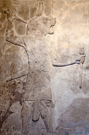 scripting: Ancient sumerian stone carving with cuneiform scripting Stock Photo