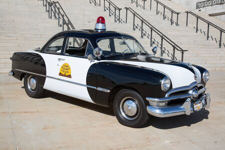 police state: Salt Lake City, Utah, USA - October 8, 2016. Historical police car in front of the Utah State Capitol. Editorial