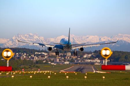 long haul journey: ZURICH - MAY 5: Oman Air A-330 landing in Zurich airport after intercontinental flight on May 5, 2016 in Zurich, Switzerland. Zurich airport is home port for Swiss Air and one of the biggest european hubs.