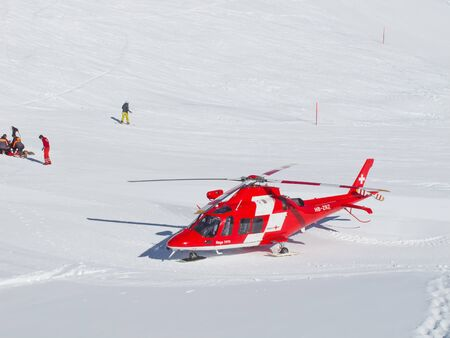 FLUMSERBERG - MARCH 5: The rescue helicopter ready to evacuate skiier after heavy accident, Flumserberg, Switzerland on March 5, 2011. Skiing safety becoming an issue on crowded slopes.