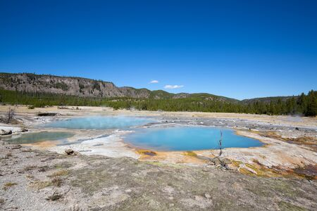 eruption: Colorful hot water pool in the Yellowstone National park, USA