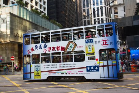 tramcar: HONG KONG - APRIL 02: Unidentified people using tram in Hong Kong on April 02, 2017. Hong Kong tram is the only in the world run with double deckers and one of the main tourist attractions. Editorial
