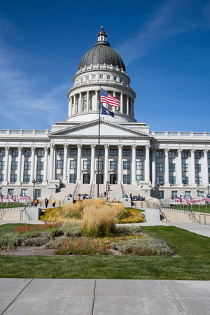 Salt Lake City, Utah, USA - October 8, 2016. Facade of the Utah State Capitol decorated with national flags. Editorial