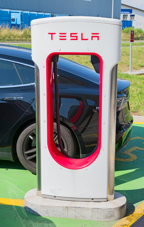 ZURICH - July 22:  Tesla Supercharger station on July 22, 2017 in Zurich, Switzerland. Tesla motors develops network of the charging stations across Europe and World.
