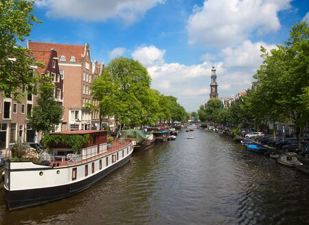 Traditional houses and river of the Amsterdam, Netherlands