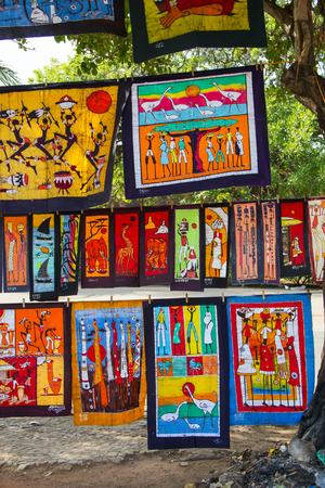 MAPUTO, MOZAMBIQUE - APRIL 29: Traditional african batik painting on the market in Maputo, Mozambique on April 29, 2012. The local market is one of the tourists attraction of the city.
