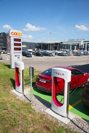 ZURICH - July 30:  Tesla Supercharger station on July 22, 2017 in Zurich, Switzerland. Tesla motors develops network of the charging stations across Europe and World. Editorial
