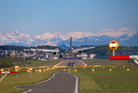 ZURICH - JULY 18: Edelweiss A-320 landing in Zurich airport on July 18, 2015 in Zurich, Switzerland. Zurich airport is home port for Swiss Air and several budget airlines. Editorial