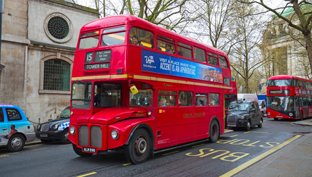 LONDON - APRIL 17: Red Double Decker Bus on the Canon street in London on April 17, 2016 in London, UK. These dobledecker bus is one of the most iconic symbol of London. Editorial