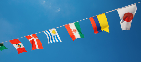 Collection of the football nations flags in the blue sky
