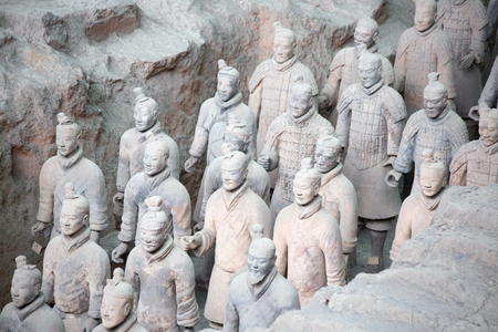 XIAN, CHINA - October 8, 2017: Famous Terracotta Army in Xian, China. The mausoleum of Qin Shi Huang, the first Emperor of China contains collection of terracotta sculptures of armored men and horses.
