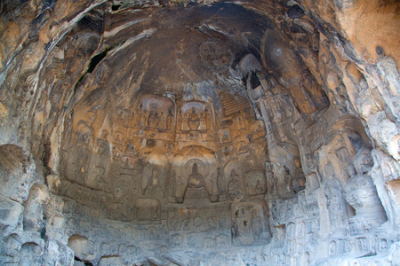 Famous Longmen Grottoes (statues of Buddha and Bodhisattvas carved in the monolith rock near Luoyang in Hennn province, China) Stock fotó - 107393306