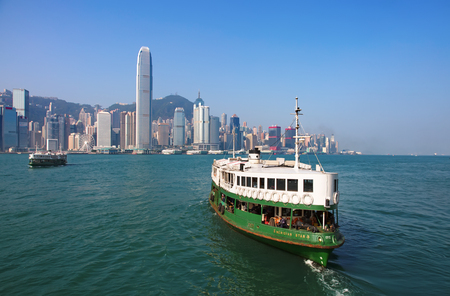 HONG KONG - APRIL 2: Ferry Meridian star cruising Victoria harbor on April 2, 2017 in Hong Kong, China. Hong Kong ferry is in operation for more than 120 years and is one of main attractions of the  報道画像