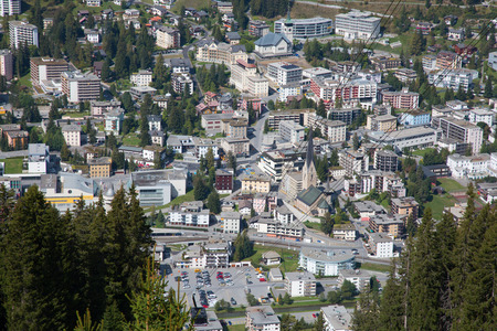 Aerial view of Davos city and lake. Davos is swiss city, famous location of annual meetings of World Economic Forum. Stock Photo