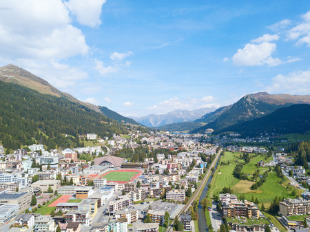 Aerial view of Davos city and lake. Davos is swiss city, famous location of annual meetings of World Economic Forum. 스톡 콘텐츠