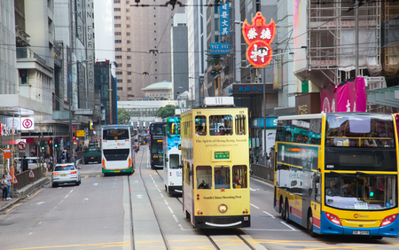 HONG KONG - APRIL 02: Unidentified people using tram in Hong Kong on April 02, 2017. Hong Kong tram is the only in the world run with double deckers and one of the main tourist attractions. Redactioneel