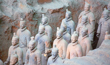 XIAN, CHINA - October 8, 2017: Famous Terracotta Army in Xian, China. The mausoleum of Qin Shi Huang, the first Emperor of China contains collection of terracotta sculptures of armored men and horses