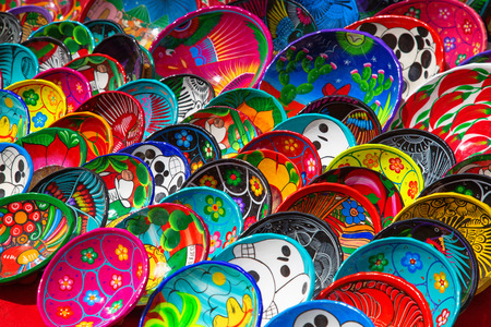 Colorful traditional mexican ceramics on the street market Фото со стока