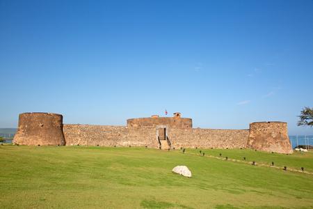 Old spanish fort on the seashore in Puerto Plata, Dominican Republic Фото со стока