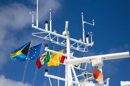 Navigation equipment and masts of cruise ship decorated with flags