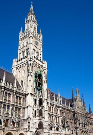 Main square of the Munich, Germany - Marienplatz (Marian square). The old and new city halls, Marian column, church Frauenkirche and Fishs fountain together are forming unique architectural style of