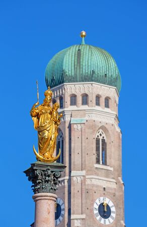 Main square of the Munich, Germany - Marienplatz (Marian square). The old and new city halls, Marian column, church Frauenkirche and Fishs fountain together are forming unique architectural style of the square